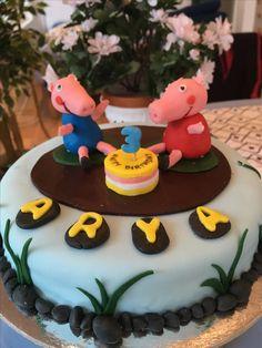 A Peppa pig themed cake.