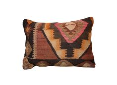 Turkish Kilim Rug Cushion | Remodelista...Above: Source a Turkish kilim floor cushion like this Kilim Kidney Pillow for $157.50 at Rummage in the US, and at Kuhfelle Online in Germany.