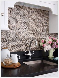 love the stone backsplash