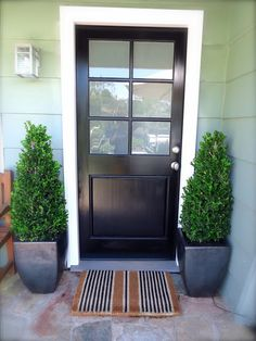 My black front door - at my cottage in the Hollywood hills. Black door, white trim, boxwood topiaries, ticking stripe  coir doormat