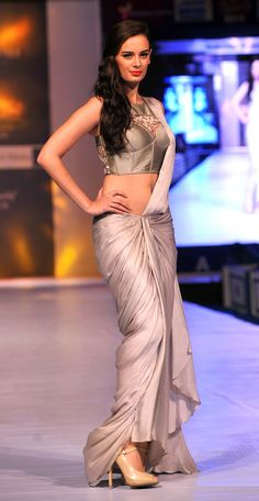 Fashion Week 2013 in Jaipur: Actress Evelyn Sharma sashayed down the ramp in a silver Sonakshi Raaj outfit which showed off her curves to perfection.
