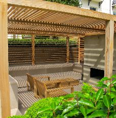 Pergola with fireplace - design by Charlotte Rowe MSGD