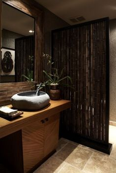 We love the dark bamboo partition to hide the toilet and the sink that looks like a large stone!