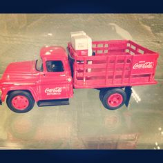 Lot #52 in the October 16th Auction. Die cast toy / model replica 1957 Chevrolet pick up with Coca-Cola advertising logos on the truck doors and pickup bed. Two vintage replica Coca-Cola vending machines are strapped into the bed of the truck. This great toy was made by ERTL. #coke #ertl #auction #toy #potofgoldauctions #chevrolet