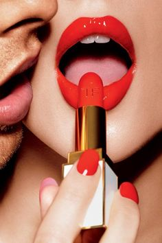 This ad is the partial obstructions of the women's face where only the bottom part is showing. The women's lips are partly open which are used to show sexual excitement or passion.