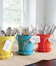 painted flower pots  saucers to hold silverware at a gathering