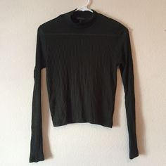 Dark green ribbed turtleneck Slightly see through so you would need to wear a nude bra or cami under. In perfect condition, worn once. Topshop Tops Tees - Long Sleeve