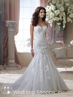 What about Beryl? This blue fit-and-flare wedding gown from David Tutera for Mon Cheri is so unique!