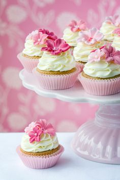 Cupcake decoration idea with pink sugared flowers. Bright and fresh for birthdays, baby showers, or bridal showers.