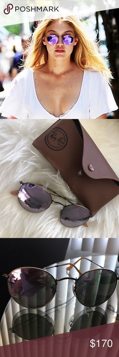 RAY BAN ROUND - Purple reflective Sunglasses Good condition. Authentic. Comes with the case and cloth. It took a lot for me to let these ones go! Best glasses I've ever owned. Ray-Ban Accessories Glasses