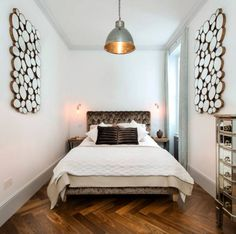 Narrow bedroom featuring wooden wall art pieces