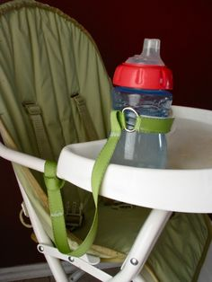 The Tippy Sippy Leash keeps sippy cups, bottles, and toys off the floor and within baby's reach. It can attach to a car seat handle or stroller as well. No more picking up bottles from a dirty floor. You win this round, Mom!
