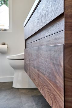 Walnut Vanity and Medicine Cabinet designed, built, and installed by Bill Fry Construction.