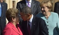 Unite the nations: Germany's chancellor, Angela Merkel, looks on as the US president, Barack Obama, kisses his Brazilian counterpart, Dilma Rousseff, as they arrive for the group photo at the G20 summit