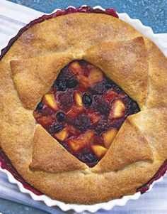 Deep-Dish Peach and Berry Pie -  					  						Make the most of two favorite fruits — succulent blueberries and juicy, sweet peaches — by baking a homemade pie.