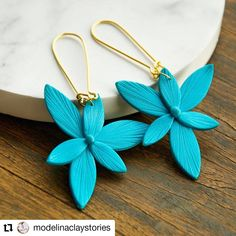 @modelinaclaystories has for you turquoise floral earrings with sterling silver gold 14k plated wire.  See more on her IG account and do not forget to follow her.  You can find her also on @etsy  #romaniancrafter #earrings #earringsoftheday #gold #personalizedgifts #gold14k #goldearrings #handmade #modelinaclaystories #handmadeearrings #etsyshop #etsy #etsyseller #etsyfinds #etsysellersofinstagram #etsyseller Earrings Handmade, Gold Earrings, Personalized Gifts, Etsy Seller, Artisan, Forget, Wire, Etsy Shop, Turquoise