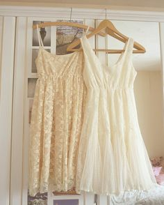 Cream and white lacy dresses.