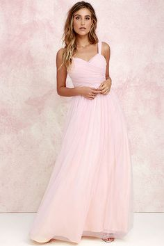 We'll make dress shopping as easy as we can for you with the Sunday Kind of Love Blush Pink Tulle Gown! You won't believe how gorgeous this maxi dress is in real life, with layers of tulle wrapping a padded sweetheart bodice (with shoulder straps), and expanding into a voluminous full skirt. Wear it as-is, or customize to your heart's desire! Hidden back zipper/clasp.