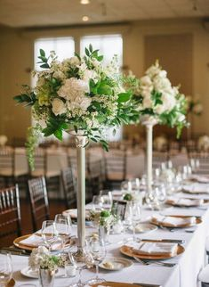 black and white wedding flower centerpieces Tall elegant table centerpieces that have white wax flower white Vintage Wedding Flowers, Wedding Reception Flowers, White Wedding Flowers, White Flowers, White Roses, Reception Ideas, Wedding Tables, White Hydrangeas, Reception Table