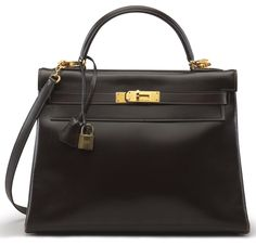 """A MARRON FONCE CALFBOX LEATHER RETOURNE KELLY 32 BAGHERMÈS, 1979Gold Hardware, interior is Marron Fonce Chèvre Leather with one zip pocket and two slip pockets. Includes lock, keys, clochette, shoulder strap, and dustbag.12½"""" W x 9½"""" H x 5"""" DBlindstamp I Circle"""