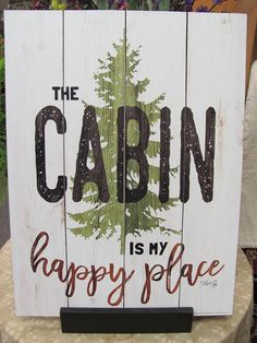 The Cabin Is My Happy Place MA2468 Measures 12x16x3/8 Wood Art Sign. Paper Art Print is adhered to a wood board. A sealer is then applied giving it a textured finish, round over black edge with a saw tooth hanger on the back for hanging. Artist Marla Rae. Handmade one at a time in our country home workshop USA. Note: I use a paper art print to make this product and not reclaimed lumber as it appears.