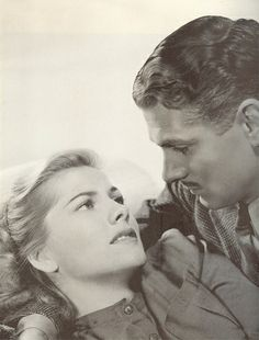 "Joan Fontaine and Sir Laurence Olivier in ""Rebecca"" (1940). COUNTRY: United States. DIRECTOR: Alfred Hitchcock."