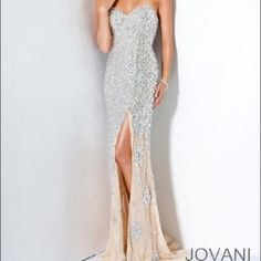 Jovani diamond prom dress It's jovani and only worn once!!! All gems are still attached and is in flawless condition. Completely authentic! Link to where I purchased: http://www.thepromdresses.com/2016_Prom_Dresses/Jovani_4247_Jeweled_Prom_Gown/ Jovani Dresses Strapless