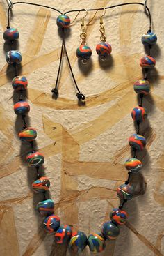 Confetti Ribbons-polymer clay beads on knotted leather cord by Page's Creations, via Flickr