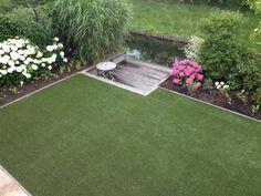 Kunstgras in bestaande tuin gelegd