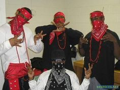 Another picture of the bloods gang with other members. All gangs have a color and hand signs that represent their gang. This gangs color is red and each hand symbol represents either their gang or where they live or what side of town they claim. Bandanas cover their face, so they hide their identity.