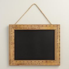 Bordered by distressed wooden rulers with a natural jute hanger, our rustic chalkboard looks like something you'd find in a small town antique shop.