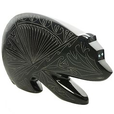 We just got this piece in and it is beautiful.  Belgain Black Marble Properties: Beauty, Cleansing, Common Sense and Mastery. Zodiac Sign: Taurus  Beautifully etched, artist Jonathan Natewa's signature bears are fine works of art. Bear is an ancient animal totem reminding us that we possess great inner strength.  Bear is a healer and brings prosperity and protection.  Keywords for bear are healing, courage, and strength.