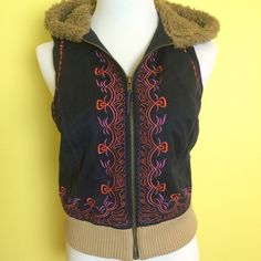 Free People vest NWOT Free people cropped embroidered vest with faux fur lined hood and floral print lining. Free People Jackets & Coats Vests