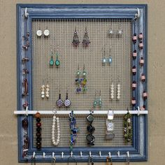 DIY Jewelry Organizer : can buy this one or make your own using a wooden frame + window screen + cup hooks + pvc pipe