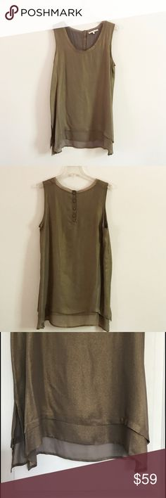 Silk Gold Hawk Top Sleeveless, 100% silk top by Gold Hawk. Size XS. 17 inches underarm to underarm, 26 1/2 inches from shoulder to hem, almost 28 inches in the back. Sheer material at the bottom hem. Color is a shimmering gold or bronze. Gold Hawk Tops