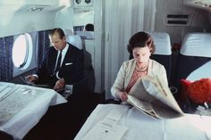 Paperwork: The Queen and Prince Philip on board a private jet in 1969
