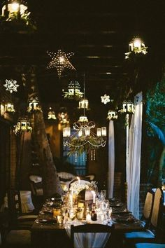 Beautiful tea light lanterns suspended above an outdoor dining table provides a magical ambiance for you and your guests #pretty #gardenentertaining