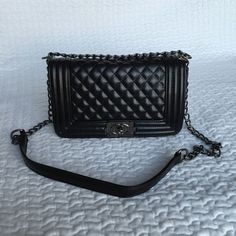 Black quilted bag Black quilted bag- NWT- in packaging, Le Boy style, can be used as long or shoulder, size is about 10Lx6Hx4W Boutique Bags Shoulder Bags