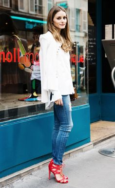 Olivia Palermo pairs her classic denim + button-down ensemble with standout red heels. // #OutfitIdeas