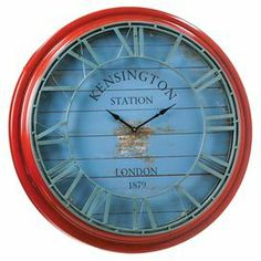 """Add charming appeal to your decor with this lovely wall clock, showcasing a distressed finish in red and blue.     Product: Wall clockConstruction Material: MetalColor: Red and blueAccommodates: Batteries - not includedDimensions: 40"""" Diameter"""