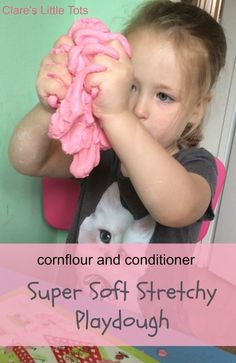 cornflour and hair conditioner playdough. Learn how to make this super soft, stretchy and strawberry scented playdough. Extra fun sensory play idea for toddlers and preschoolers.