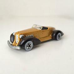 1983 Hot Wheels Car - Auburn 852, Metallic Gold with Black Fenders and White Wall Wheels