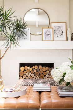 Open and airy living room with round wall mirror above the mantel
