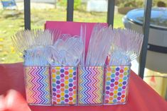 Cute Cutlery Holder Idea - glass vase with scrapbook paper liner.