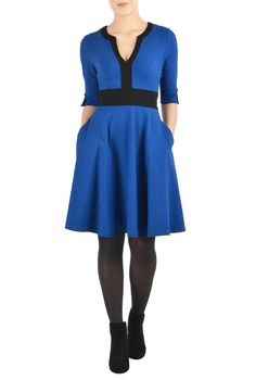 A flared skirt below the contrast banded waist highlights the feminine figure in our smart colorblock dress cut from stretchy cotton knit.<li>Slips on over head; partial side hidden zip closure.<li>Contrast banded split neck. <li>Elbow-length sleeves with contrast trim at the split cuffs. <li>Princess seamed bodice.<li>Side seam pockets. <li>Above knee length. <li>Cotton/spandex, jersey knit, structured feel, light stretch, midweight. <li>Machine wash cold.