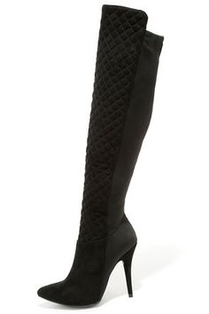 "If you plan on going out tonight, we give you permission to get a little wild and crazy in the Feel Like a Woman Black Suede Over the Knee Boots! These ultra sexy OTK's have a sassy pointed-toe upper (covered in the vegan suede) that travels to a quilted 21"" shaft with stretch knit back. 10.5"" zipper at the instep."
