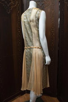 1920s Lace and Silk Georgette Dress Early 1920s dress made from gold lamé lace threads featuring a peach silk georgette inserts, matching peach silk slip, and drop waist peach velvet belt.  Back 3/4 view - Right side 5