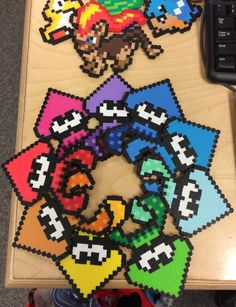 Splatoon squiddies! Yay! I'm so excited for this game I just had to make perlers of them. So I sat down on saturday, opened up pics of the inkling squids and did this off of that! I really like how they came out.  My awesome friend amandahildisheim is going to be selling them for me at Dcaf in Dartmouth and Hal-Con!