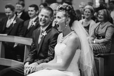 A funny documentary photograph of a bride and groom laughing during their wedding ceremony at a small church in Boston, Massachusetts Gina Brocker Photography