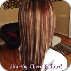 Dark brown over all color with blonde & red highlights